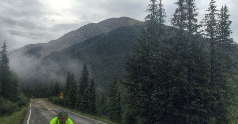 Camran Taylor riding his Ritte Bike on highway 82 going over Independence Pass